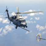 An U.S. Air Force HH-60G Pavehawk helicopter from the 55th Rescue Squadron flies above the Pacific Ocean in route to rescue two critically burned sailors 600 nautical miles of the coast of Mexico May 5, 2014. Airmen from the 563rd Rescue Group flew in a 79th RQS HC-130J Combat King II aircraft for nearly 11 hours, to parachute Guardian Angel teams near the ship, with two inflatable zodiac boat packages and medical equipment, so that they could deliver lifesaving care and stabilize the injured sailors. Guardian Angels are the only Department of Defense combat forces specifically organized, trained, equipped, and postured to conduct full spectrum personnel recovery operations. (U.S. Air Force photo by Staff Sgt. Adam Grant)