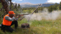 Hunter fires a Hawken muzzle-loading rifle. Photo courtesy of  Colorado Division of Wildlife. Photographer, Dennis McKinney