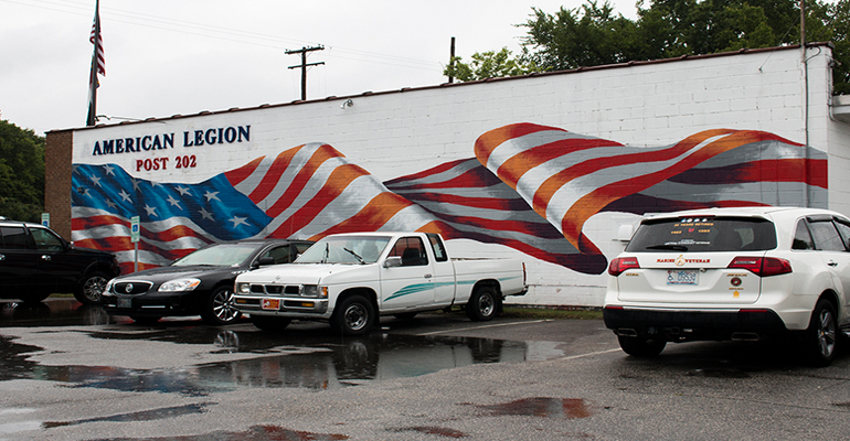 "This American flag mural at American Legion Post 202 in Fayetteville, North Carolina, gained national notoriety when it was featured in a segment on the ""Steve Harvey"" show. (Photo by Michael Olinger/News21)"