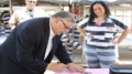 Sheriff Arpaio autographs postcards for inmates on the 23rd Anniversary of Tent City Jail, August 3, 2016