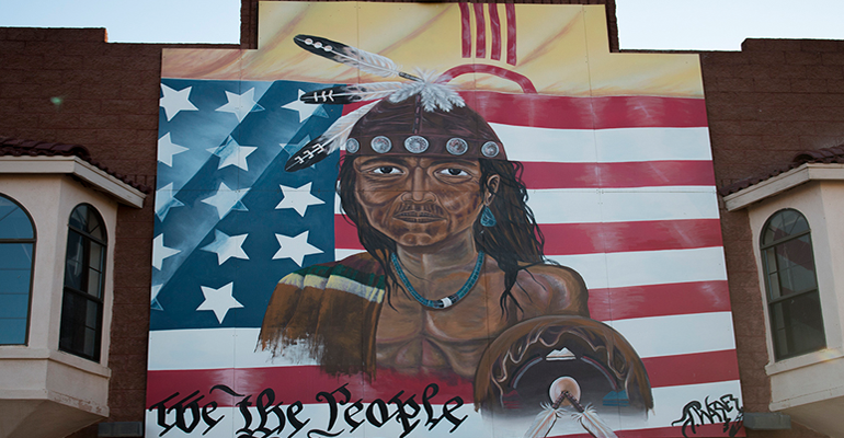 Mural of a Native American on the side of a trading post that sold goods from tribes on the Navajo Nation near Gallup, New Mexico. (Photo by Mike Lakusiak/News21)