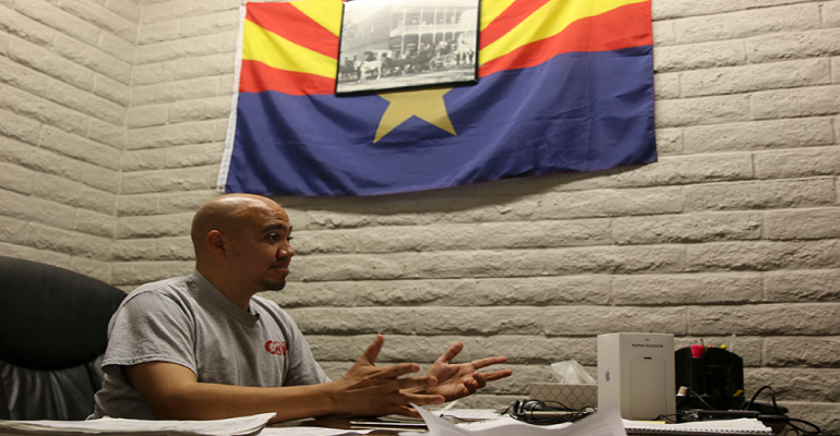 Sergio Arellano discusses Republican strategy for recruiting Latino voters at the Arizona GOP headquarters in Phoenix on Aug. 29, 2016. (Photo by Danielle Quijada/Cronkite News)