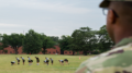 As soldiers do their morning workout, Sgt. 1st Class Jose R. Colon looks on. Physical training at Fort Bragg starts every weekday at 6 a.m. (Photo by Michael Olinger/News21)