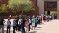 Voters wait in line outside a polling place in Tempe during the presidential preference election, when widespread problems resulted in hours-long waits for many in Maricopa County. (Photo by Grecia Drabos/Cronkite News)