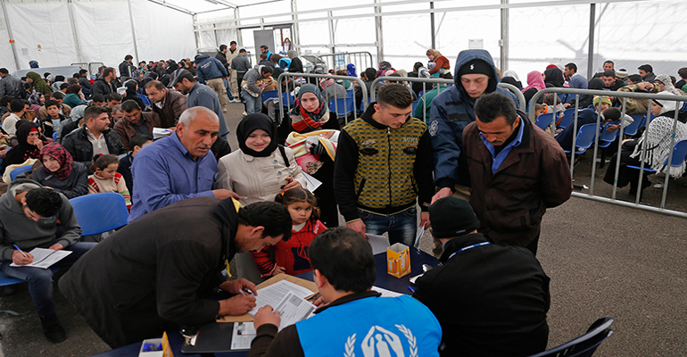 Syrian families at a United Nations refugees center in Lebanon in 2014. Arizona received 833 Syrian refugees in just-ended fiscal 2016, trailing only three other states in the nation that year. (Photo by Mohamed Azakir/World Bank)  Displaced Syrian children in a classroom at a Jordanian refugee camp in January 2012. Camps like this housed tens of thousands of refugees fleeing war in Syria. (Photo by Mark Garten/United Nations)
