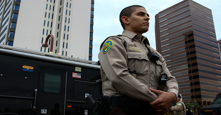 Niko Vazquez, 26, a volunteer member of the Maricopa County Sheriff's Posse, spoke positively about his posse service at a press conference near Park Central Mall on Nov. 28, 2016. (Photo by Danielle Quijada/Cronkite News)