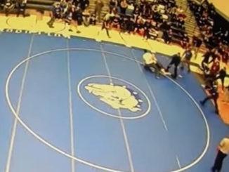 wrestler tackles coach