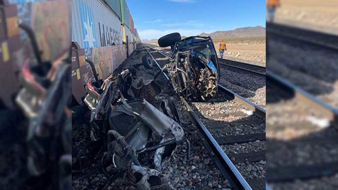 train collides with vehicle